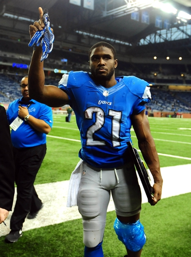 Nov 28, 2013; Detroit, MI, USA; Detroit Lions running back Reggie Bush (21) acknowledges the crowd after defeating the Green Bay Packers 40-10 during a NFL football game on Thanksgiving at Ford Field. Mandatory Credit: Andrew Weber-USA TODAY Sports