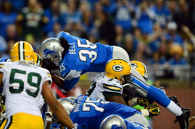 Nov 28, 2013; Detroit, MI, USA; Detroit Lions running back Joique Bell (35) dives into the end zone for a touchdown during the fourth quarter of a NFL football game against the Green Bay Packers on Thanksgiving at Ford Field. Mandatory Credit: Andrew Weber-USA TODAY Sports