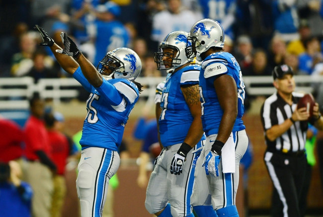 Nov 28, 2013; Detroit, MI, USA; Detroit Lions running back Joique Bell (35) celebrates with teammates after scoring a touchdown during the fourth quarter of a NFL football game against the Green Bay Packers on Thanksgiving at Ford Field. Mandatory Credit: Andrew Weber-USA TODAY Sports