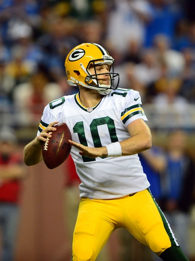 Nov 28, 2013; Detroit, MI, USA; Green Bay Packers quarterback Matt Flynn (10) looks to pass during the fourth quarter of a NFL football game against the Detroit Lions on Thanksgiving at Ford Field. Mandatory Credit: Andrew Weber-USA TODAY Sports