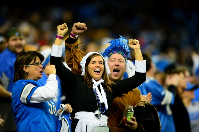 Nov 28, 2013; Detroit, MI, USA; Detroit Lions fans dressed as pilgrims cheer during the fourth quarter of a NFL football game against the Green Bay Packers on Thanksgiving at Ford Field. Mandatory Credit: Andrew Weber-USA TODAY Sports