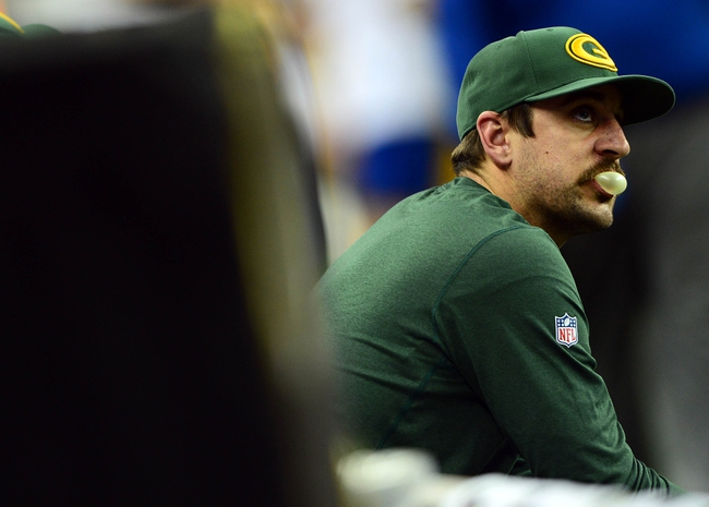 Nov 28, 2013; Detroit, MI, USA; Green Bay Packers quarterback Aaron Rodgers (12) sits on the bench during the fourth quarter of a NFL football game against the Detroit Lions on Thanksgiving at Ford Field. Mandatory Credit: Andrew Weber-USA TODAY Sports