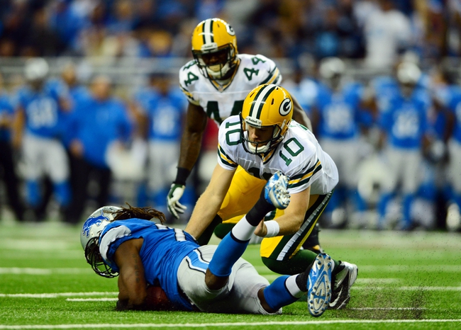 Nov 28, 2013; Detroit, MI, USA; Green Bay Packers quarterback Matt Flynn (10) fumbles the ball during the fourth quarter of a NFL football game against the Detroit Lions on Thanksgiving at Ford Field. Mandatory Credit: Andrew Weber-USA TODAY Sports