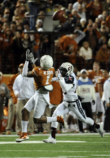 Nov 28, 2013; Austin, TX, USA; Texas Longhorns wide reciver Mike Davis (1)makes a catch against Texas Tech Red Raiders defensive back Olaoluwa Falemi (29) during the second quarter at Darrell K Royal-Texas Memorial Stadium. Mandatory Credit: Brendan Maloney-USA TODAY Sports