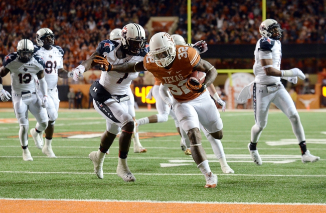 Nov 28, 2013; Austin, TX, USA; Texas Longhorns tailback Joe Bergeron (32), scores a touchdown ahead of Texas Tech Red Raiders linebacker Will Smith (7) during the second quarter at Darrell K Royal-Texas Memorial Stadium. Mandatory Credit: Brendan Maloney-USA TODAY Sports