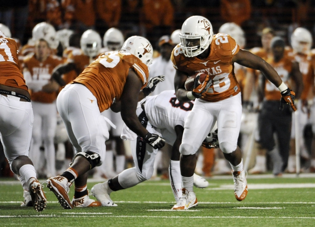 Nov 28, 2013; Austin, TX, USA; Texas Longhorns tailback Malcolm Brown (28) carries the ball against the Texas Tech Red Raiders during the second half at Darrell K Royal-Texas Memorial Stadium. Texas beat Texas Tech 41-16. Mandatory Credit: Brendan Maloney-USA TODAY Sports