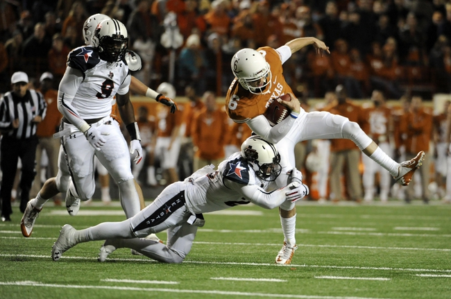 Nov 28, 2013; Austin, TX, USA; Texas Longhorns quarterback Case McCoy (6) carries the ball against Texas Tech Red Raiders defensive back Tanner Jacobson (20) and linebacker Branden Jacskon (9) during the second half at Darrell K Royal-Texas Memorial Stadium. Texas beat Texas Tech 41-16. Mandatory Credit: Brendan Maloney-USA TODAY Sports