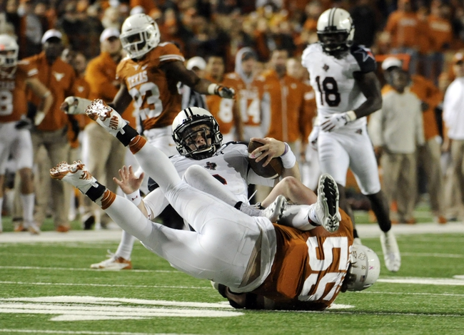 Nov 28, 2013; Austin, TX, USA; Texas Longhorns linebacker Dalton Santos (55) tackles Texas Tech Red Raiders quarterback Baker Mayfield (6) during the second half at Darrell K Royal-Texas Memorial Stadium. Texas beat Texas Tech 41-16. Mandatory Credit: Brendan Maloney-USA TODAY Sports