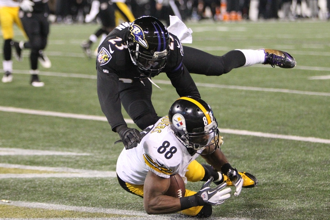 Nov 28, 2013; Baltimore, MD, USA; Pittsburgh Steelers wide receiver Emmanual Sanders (88) cannot catch a two point conversion attempt in the fourth quarter against Baltimore Ravens cornerback Chykie Brown (23) during a NFL football game on Thanksgiving at M&T Bank Stadium. Mandatory Credit: Mitch Stringer-USA TODAY Sports