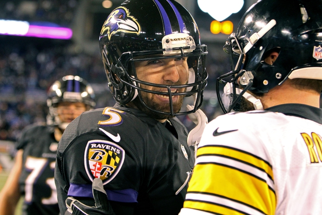 Nov 28, 2013; Baltimore, MD, USA; Baltimore Ravens quarterback Joe Flacco (5) greets Pittsburgh Steelers quarterback Ben Roethlisberger (7) after the NFL football game on Thanksgiving at M&T Bank Stadium. Mandatory Credit: Mitch Stringer-USA TODAY Sports