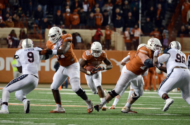 Nov 28, 2013; Austin, TX, USA; Texas Longhorns running back Malcolm Brown (28) runs the ball against the Texas Tech Red Raiders during the second half at Darrell K Royal-Texas Memorial Stadium. Texas beat Texas Tech 41-16. Mandatory Credit: Brendan Maloney-USA TODAY Sports
