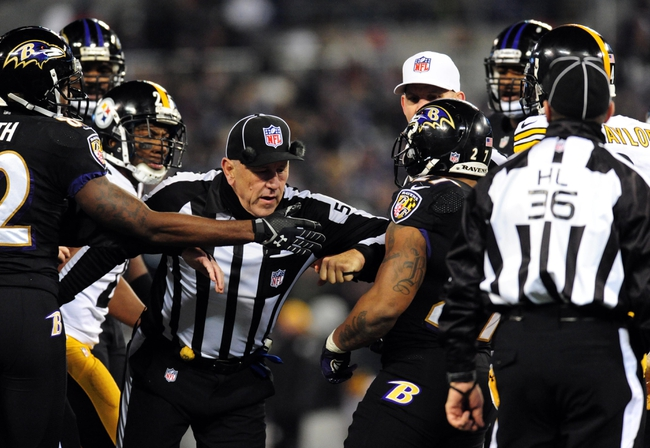 Nov 28, 2013; Baltimore, MD, USA; Officials try to hold back Baltimore Ravens running back Ray Rice (27) during a fight with Pittsburgh Steelers defensive back Ryan Clark during a NFL football game on Thanksgiving at M&T Bank Stadium. Mandatory Credit: Evan Habeeb-USA TODAY Sports