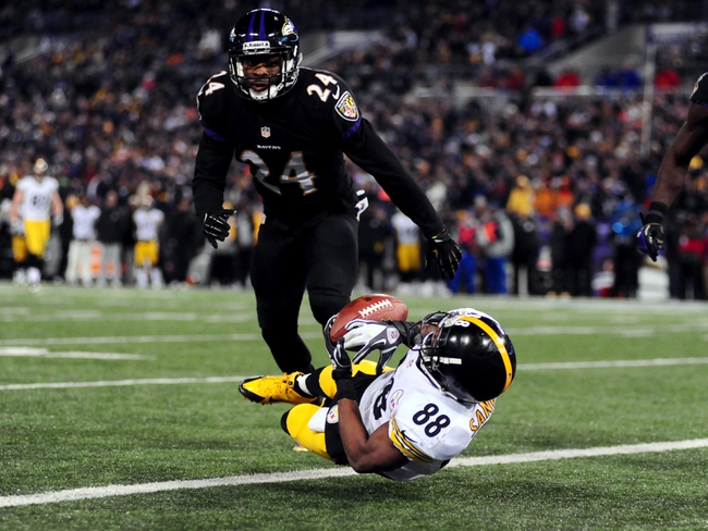 Nov 28, 2013; Baltimore, MD, USA; Pittsburgh Steelers wide receiver Emmanuel Sanders (88) cannot catch the ball in the end zone against Baltimore Ravens cornerback Corey Graham (24) during a NFL football game on Thanksgiving at M&T Bank Stadium. Mandatory Credit: Evan Habeeb-USA TODAY Sports