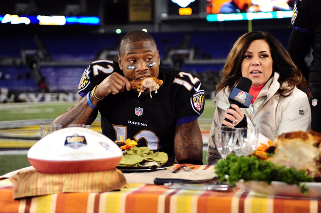 Nov 28, 2013; Baltimore, MD, USA; Baltimore Ravens wide receiver Jacoby Jones (12) eats a turkey leg while being interviewed by NBC personality Michele Tafoya (right) after beating the Pittsburgh Steelers 22-20 during a NFL football game on Thanksgiving at M&T Bank Stadium. Mandatory Credit: Evan Habeeb-USA TODAY Sports