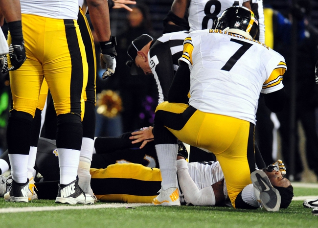 Nov 28, 2013; Baltimore, MD, USA; Pittsburgh Steelers quarterback Ben Roethlisberger (7) checks on running back Le'Veon Bell (26) after an injury in the fourth quarter against the Baltimore Ravens during a NFL football game on Thanksgiving at M&T Bank Stadium. Mandatory Credit: Evan Habeeb-USA TODAY Sports