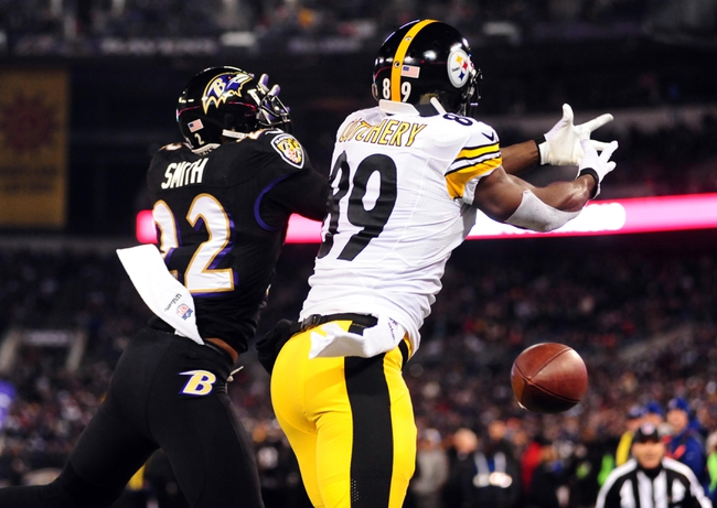Nov 28, 2013; Baltimore, MD, USA; Baltimore Ravens cornerback Jimmy Smith (22) knocks the ball away from Pittsburgh Steelers wide receiver Jerricho Cotchery (89) during a NFL football game on Thanksgiving at M&T Bank Stadium. Mandatory Credit: Evan Habeeb-USA TODAY Sports