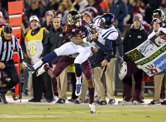 Nov 28, 2013; Starkville, MS, USA; Mississippi Rebels wide receiver Vince Sanders (10) catches a pass against Mississippi State Bulldogs defensive back Taveze Calhoun (23) during the game at Davis Wade Stadium. Mississippi State Bulldogs defeat the Mississippi Rebels with a score of 17-10 in overtime.  Mandatory Credit: Spruce Derden-USA TODAY Sports