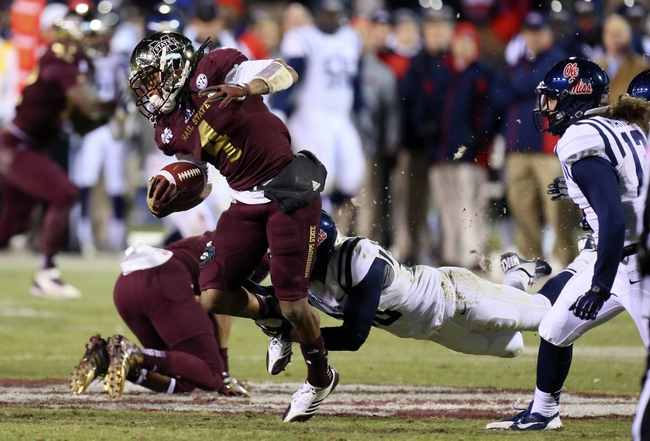 Nov 28, 2013; Starkville, MS, USA; Mississippi State Bulldogs wide receiver Jameon Lewis (4) advances the ball during the game against the Mississippi Rebels at Davis Wade Stadium. Mississippi State Bulldogs defeat the Mississippi Rebels with a score of 17-10 in overtime.  Mandatory Credit: Spruce Derden-USA TODAY Sports