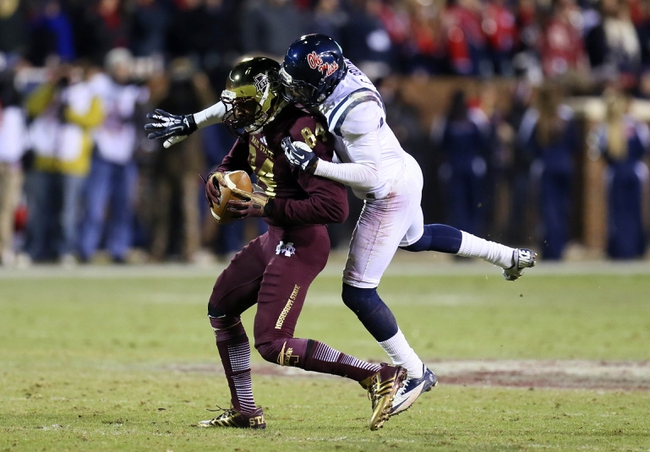 Nov 28, 2013; Starkville, MS, USA; Mississippi State Bulldogs wide receiver Jeremey Chappelle (84) makes reception and is tackled by Mississippi Rebels defensive back Chief Brown (8) during the game at Davis Wade Stadium. Mississippi State Bulldogs defeat the Mississippi Rebels with a score of 17-10 in overtime.  Mandatory Credit: Spruce Derden-USA TODAY Sports