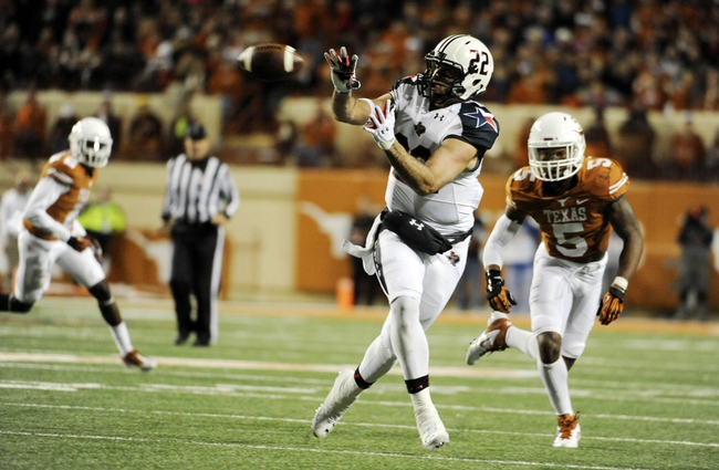 Nov 28, 2013; Austin, TX, USA; Texas Tech Red Raiders wide receiver Jace Amaro (22) attempts to catch a pass against Texas Longhorns safety Josh Turner (5) during the first half at Darrell K Royal-Texas Memorial Stadium. Texas beat Texas Tech 41-16. Mandatory Credit: Brendan Maloney-USA TODAY Sports