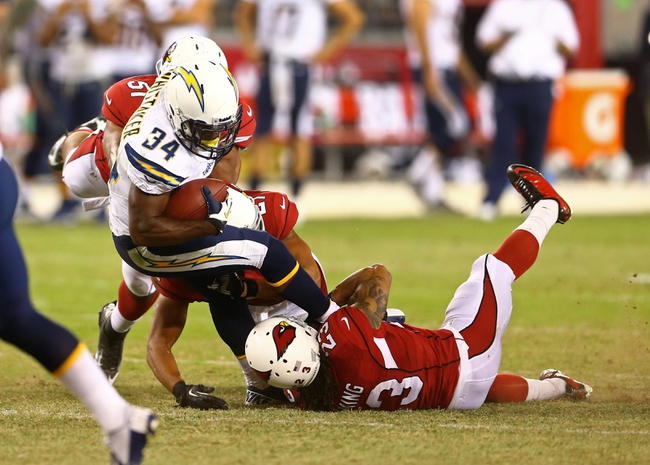 Aug. 24, 2013; Glendale, AZ, USA: San Diego Chargers running back Fozzy Whittaker (34) against the Arizona Cardinals during a preseason game at University of Phoenix Stadium. Mandatory Credit: Mark J. Rebilas-USA TODAY Sports