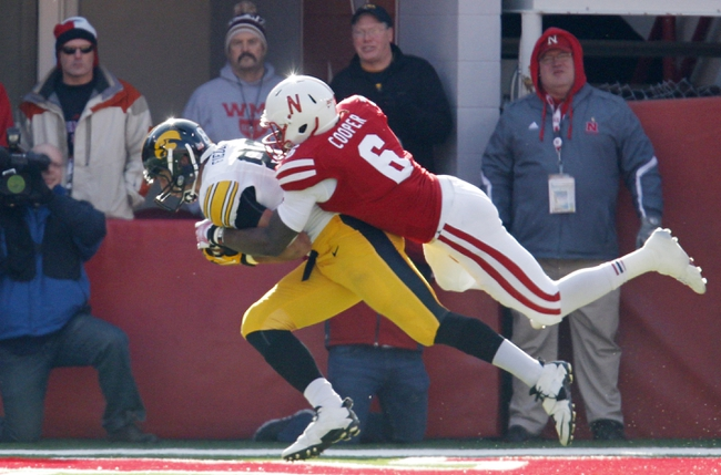 Nov 29, 2013; Lincoln, NE, USA; Iowa Hawkeyes receiver C.J. Fiedorowicz (86) catches the touchdown pass against Nebraska Cornhuskers defender Corey Cooper (6) in the first quarter at Memorial Stadium. Mandatory Credit: Bruce Thorson-USA TODAY Sports