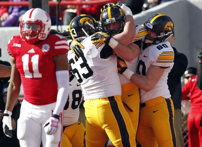 Nov 29, 2013; Lincoln, NE, USA; Iowa Hawkeyes running back Mark Weisman (45) is congratulated by his teammates after scoring a touchdown against Nebraska Cornhuskers in the second quarter at Memorial Stadium. Mandatory Credit: Bruce Thorson-USA TODAY Sports