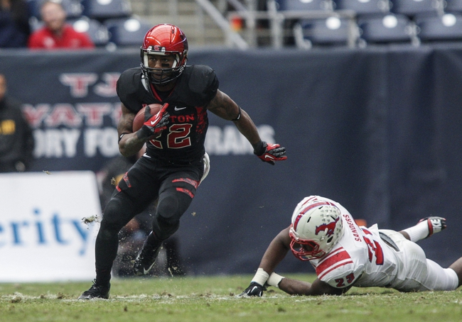 Nov 29, 2013; Houston, TX, USA; Houston Cougars running back Ryan Jackson (22) runs with the ball during the second quarter against the Southern Methodist Mustangs at Reliant Stadium. Mandatory Credit: Troy Taormina-USA TODAY Sports