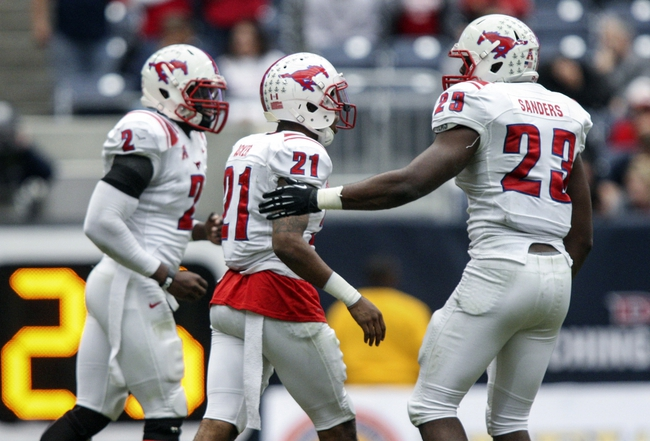 Nov 29, 2013; Houston, TX, USA; Southern Methodist Mustangs defensive back Kenneth Acker (21) is congratulated by linebacker Stephon Sanders (23) after making an interception during the second quarter against the Houston Cougars at Reliant Stadium. Mandatory Credit: Troy Taormina-USA TODAY Sports
