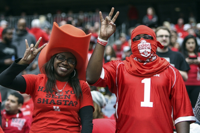 Nov 29, 2013; Houston, TX, USA; Houston Cougars fans cheer during the second quarter against the Southern Methodist Mustangs at Reliant Stadium. Mandatory Credit: Troy Taormina-USA TODAY Sports