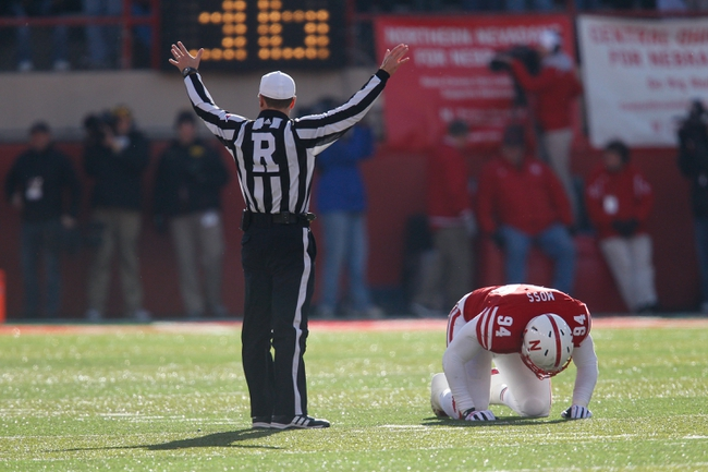 Nov 29, 2013; Lincoln, NE, USA; Nebraska Cornhuskers defender Avery Moss (94) is injured as official Alex Kemp calls timeout during the game against the Iowa Hawkeyes in the fourth quarter at Memorial Stadium. Iowa won 38-17. Mandatory Credit: Bruce Thorson-USA TODAY Sports