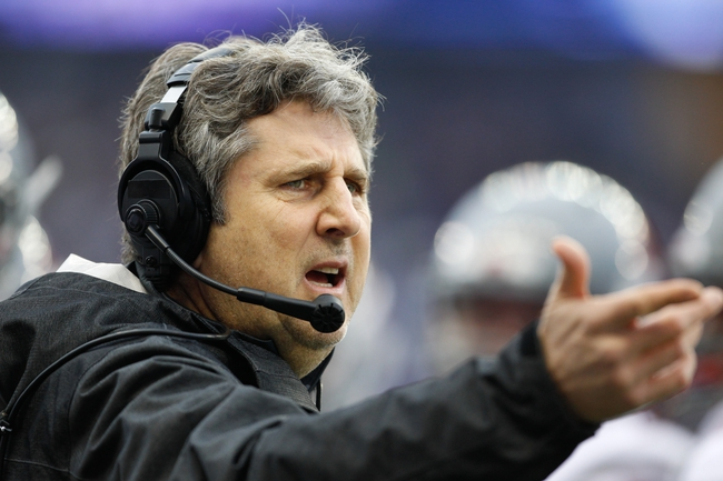 Nov 29, 2013; Seattle, WA, USA; Washington State Cougars head coach Mike Leach speaks with an official about a call in favor of the Washington Huskies during the first quarter at Husky Stadium. Mandatory Credit: Joe Nicholson-USA TODAY Sports