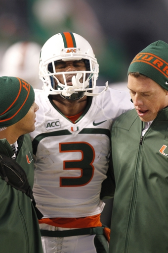 Nov 29, 2013; Pittsburgh, PA, USA; Miami Hurricanes wide receiver Stacy Coley (3) is helped off of the field after being injured against the Pittsburgh Panthers during the second quarter at Heinz Field. Mandatory Credit: Charles LeClaire-USA TODAY Sports