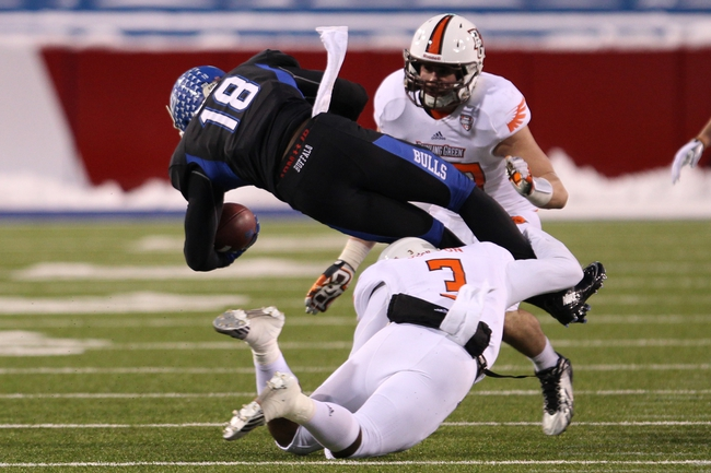 Nov 29, 2013; Buffalo, NY, USA; Bowling Green Falcons defensive back Brian Sutton (3) makes a tackle on Buffalo Bulls wide receiver Fred Lee (18) during the second half at Ralph Wilson Stadium. Bowling Green beat Buffalo 24 to 7.  Mandatory Credit: Timothy T. Ludwig-USA TODAY Sports