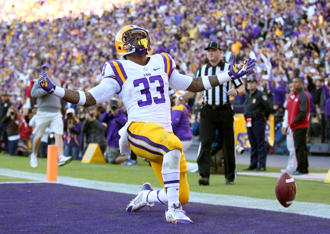 Nov 29, 2013; Baton Rouge, LA, USA; LSU Tigers running back Jeremy Hill (33) celebrates a touchdown against the Arkansas Razorbacks in the second half at Tiger Stadium. LSU defeated Arkansas 31-27. Mandatory Credit: Crystal LoGiudice-USA TODAY Sports