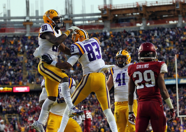 Nov 29, 2013; Baton Rouge, LA, USA; LSU Tigers wide receiver Travin Dural (83) and wide receiver Jarvis Landry (80) celebrate after a touchdown in the fourth quarter at Tiger Stadium. LSU defeated Arkansas 31-27. Mandatory Credit: Crystal LoGiudice-USA TODAY Sports