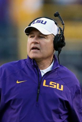 Nov 29, 2013; Baton Rouge, LA, USA; LSU Tigers head coach Les Miles watches from the sideline in the second half against the Arkansas Razorbacks at Tiger Stadium. LSU defeated Arkansas 31-27. Mandatory Credit: Crystal LoGiudice-USA TODAY Sports