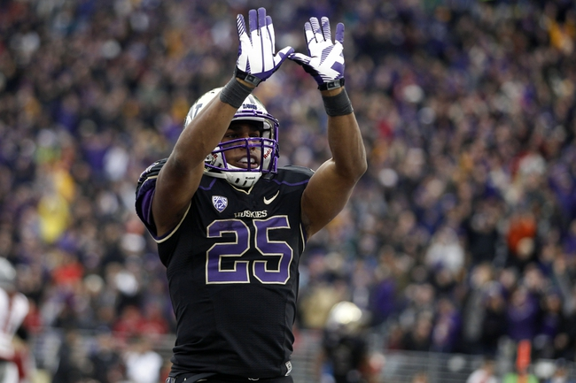 Nov 29, 2013; Seattle, WA, USA; Washington Huskies running back Bishop Sankey (25) celebrates after rushing for a touchdown against the Washington State Cougars during the third quarter at Husky Stadium. The touchdown by Sankey set a new personal career record for rushing touchdowns at Washington. Mandatory Credit: Joe Nicholson-USA TODAY Sports