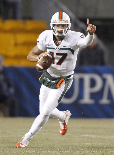 Nov 29, 2013; Pittsburgh, PA, USA; Miami Hurricanes quarterback Stephen Morris (17) gestures as he scrambles with the ball against the Pittsburgh Panthers during the third quarter at Heinz Field. Miami won 41-31. Mandatory Credit: Charles LeClaire-USA TODAY Sports