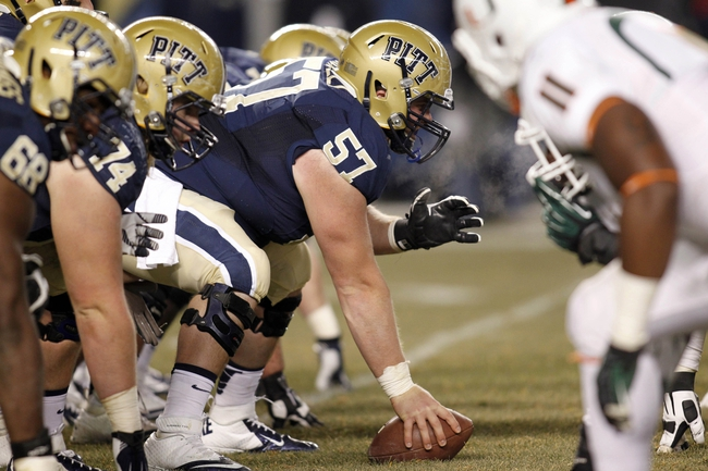 Nov 29, 2013; Pittsburgh, PA, USA; Pittsburgh Panthers offensive linesman Artie Rowell (57) prepares to snap the ball against the Miami Hurricanes during the fourth quarter at Heinz Field. Miami won 41-31. Mandatory Credit: Charles LeClaire-USA TODAY Sports