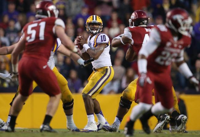 Nov 29, 2013; Baton Rouge, LA, USA; LSU Tigers quarterback Anthony Jennings (10) looks to pass the ball against the Arkansas Razorbacks at Tiger Stadium. LSU defeated Arkansas 31-27. Mandatory Credit: Crystal LoGiudice-USA TODAY Sports