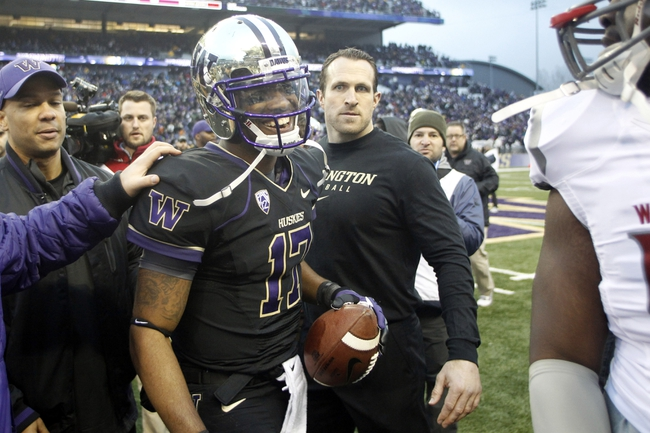 Nov 29, 2013; Seattle, WA, USA; Washington Huskies quarterback Keith Price (17) talks with a player on the Washington State Cougars following a 27-17 Washington victory at Husky Stadium. Mandatory Credit: Joe Nicholson-USA TODAY Sports