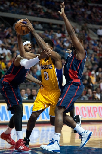 Nov 29, 2013; Auburn Hills, MI, USA; Detroit Pistons small forward Josh Smith (6) fouls Los Angeles Lakers small forward Nick Young (0) during the first quarter at The Palace of Auburn Hills. Mandatory Credit: Tim Fuller-USA TODAY Sports