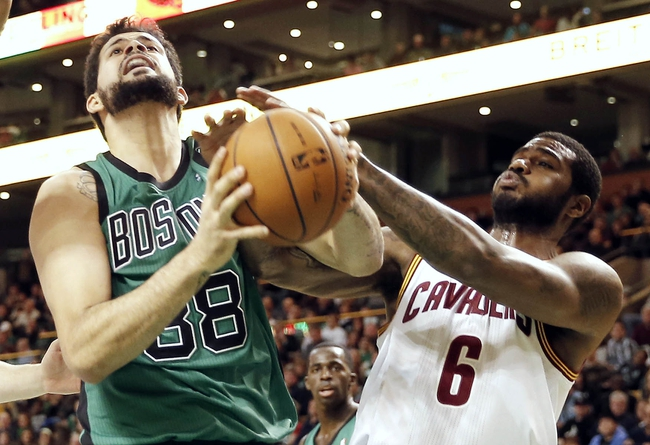 Nov 29, 2013; Boston, MA, USA; Boston Celtics center Vitor Faverani (38) battles with Cleveland Cavaliers small forward Earl Clark (6) for the ball during the first quarter at TD Garden. Mandatory Credit: Winslow Townson-USA TODAY Sports