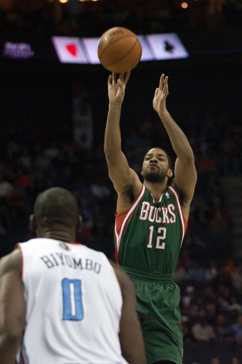 Nov 29, 2013; Charlotte, NC, USA; Milwaukee Bucks shooting guard Gary Neal (12) shoots the ball during the first half against the Charlotte Bobcats at Time Warner Cable Arena. Mandatory Credit: Jeremy Brevard-USA TODAY Sports