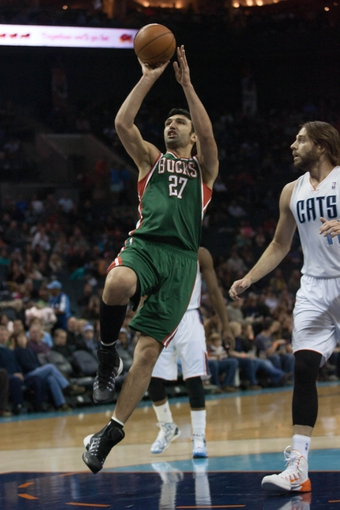Nov 29, 2013; Charlotte, NC, USA; Milwaukee Bucks center Zaza Pachulia (27) shoots the ball during the first half against the Charlotte Bobcats at Time Warner Cable Arena. Mandatory Credit: Jeremy Brevard-USA TODAY Sports