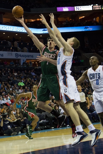 Nov 29, 2013; Charlotte, NC, USA; Milwaukee Bucks power forward Ersan Ilyasova (7) shoots the ball over Charlotte Bobcats center Cody Zeller (40) during the first half at Time Warner Cable Arena. Mandatory Credit: Jeremy Brevard-USA TODAY Sports