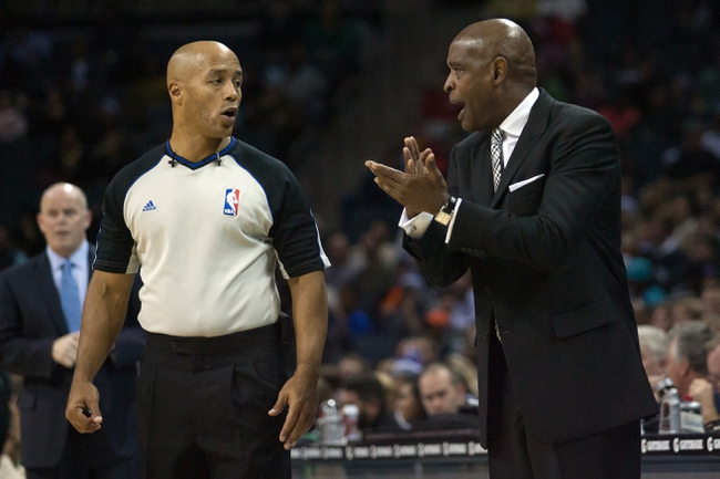 Nov 29, 2013; Charlotte, NC, USA; Milwaukee Bucks head coach Larry Drew argues with a referee after being called for a technical foul during the first half against the Charlotte Bobcats at Time Warner Cable Arena. Mandatory Credit: Jeremy Brevard-USA TODAY Sports
