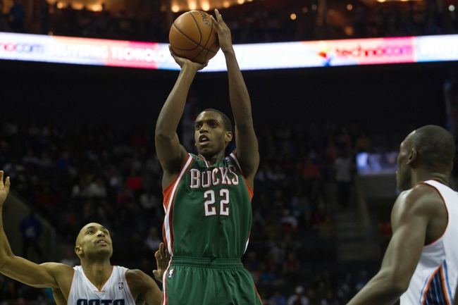 Nov 29, 2013; Charlotte, NC, USA; Milwaukee Bucks power forward Khris Middleton (22) shoots the ball during the first half against the Charlotte Bobcats at Time Warner Cable Arena. Mandatory Credit: Jeremy Brevard-USA TODAY Sports