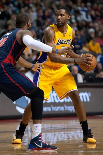 Nov 29, 2013; Auburn Hills, MI, USA; Detroit Pistons power forward Greg Monroe (10) guards Los Angeles Lakers power forward Shawne Williams (3) during the second quarter at The Palace of Auburn Hills. Mandatory Credit: Tim Fuller-USA TODAY Sports